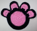 pink and black crocheted pawprint